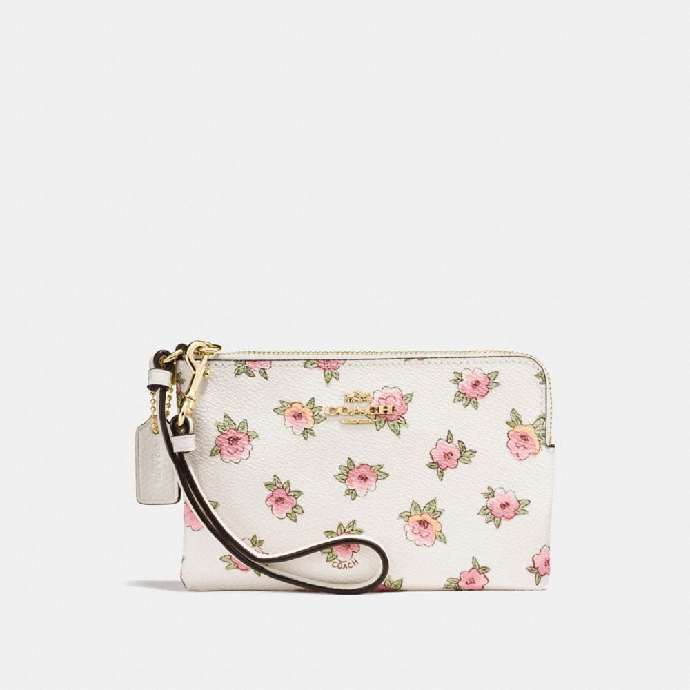 SMALL WRISTLET IN FLOWER PATCH PRINT COATED CANVAS