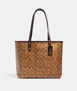 REVERSIBLE CITY TOTE IN SIGNATURE CANVAS WITH BUTTERFLY PRINT