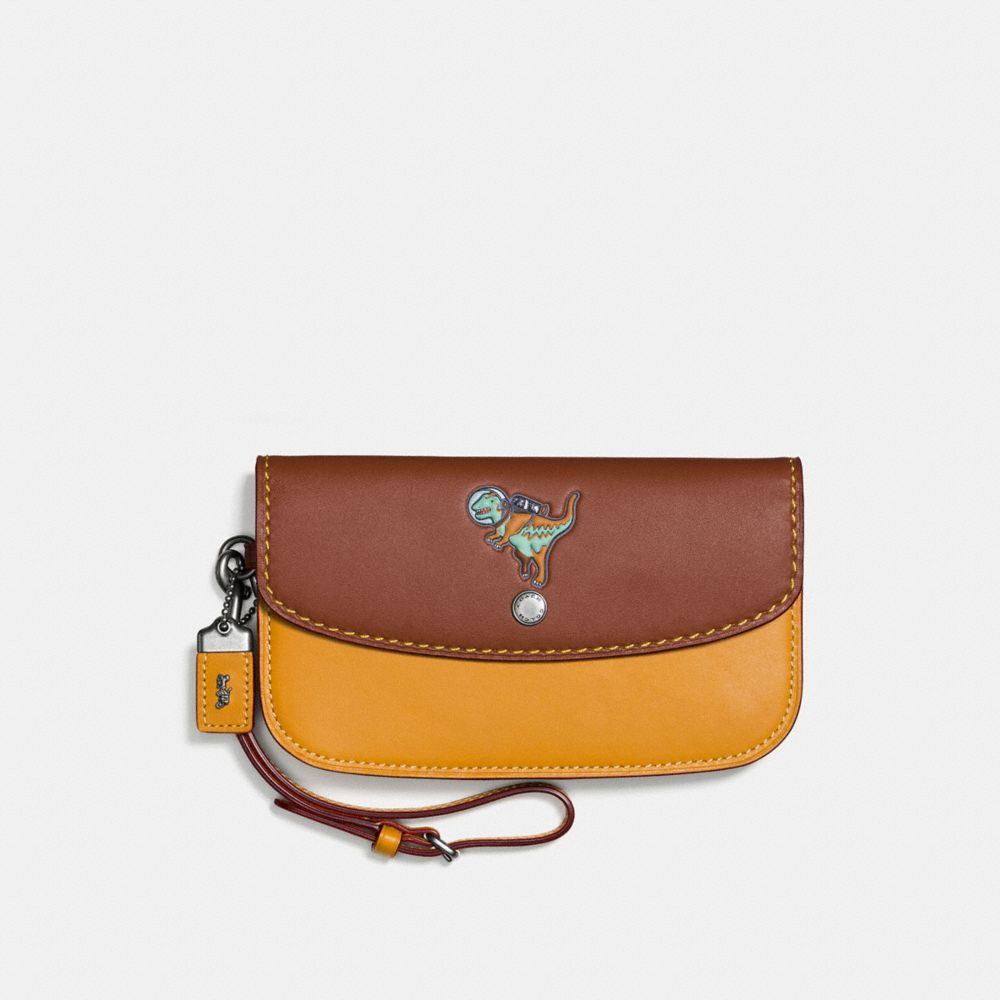 CLUTCH IN GLOVETANNED LEATHER WITH EMBOSSED SPACE REXY