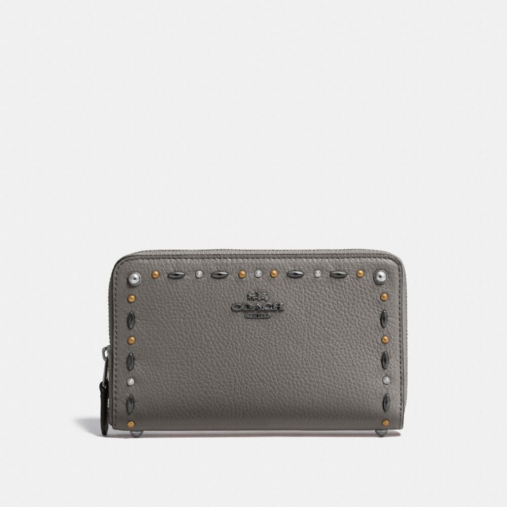 MEDIUM ZIP AROUND WALLET WITH PRAIRIE RIVETS