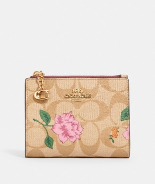 SNAP CARD CASE IN SIGNATURE CANVAS WITH PRAIRIE ROSE PRINT