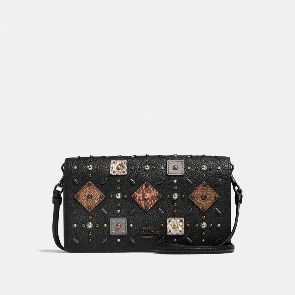 FOLDOVER CROSSBODY CLUTCH WITH PRAIRIE RIVETS AND SNAKESKIN DETAIL