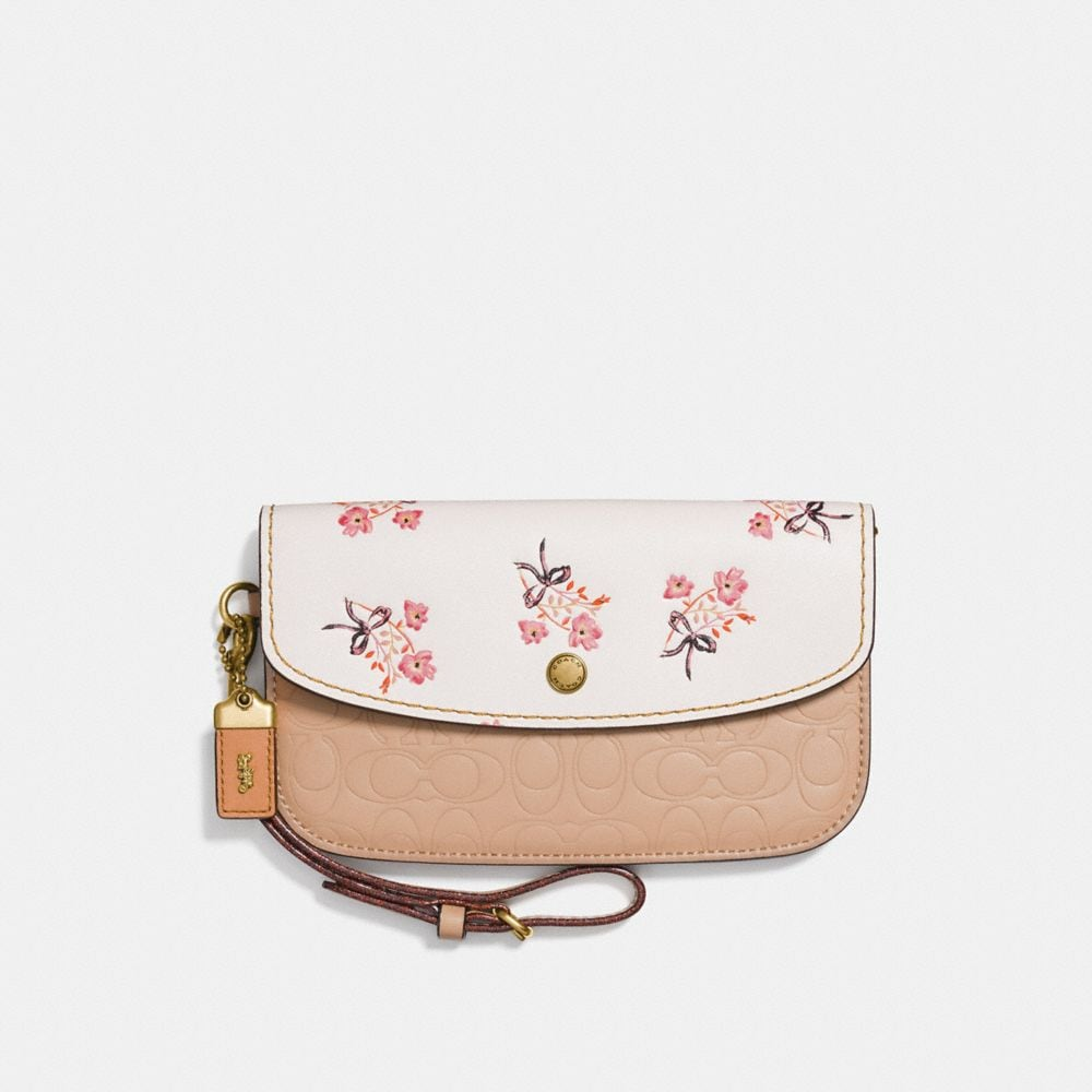 CLUTCH IN SIGNATURE LEATHER WITH FLORAL BOW PRINT