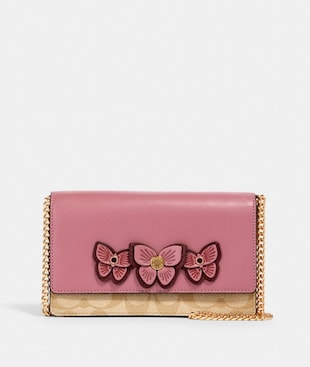 FLAP BELT BAG IN SIGNATURE CANVAS WITH BUTTERFLY APPLIQUE