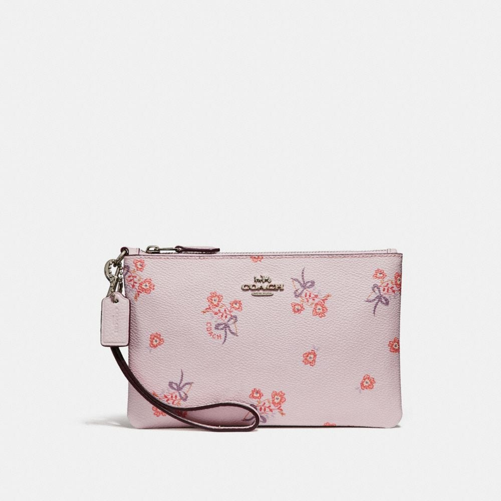 SMALL WRISTLET WITH FLORAL BOW PRINT
