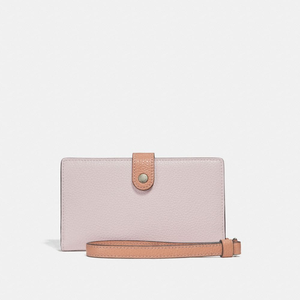 PHONE WRISTLET IN COLORBLOCK WITH PRINTED INTERIOR