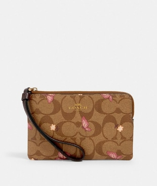 CORNER ZIP WRISTLET IN SIGNATURE CANVAS WITH BUTTERFLY PRINT