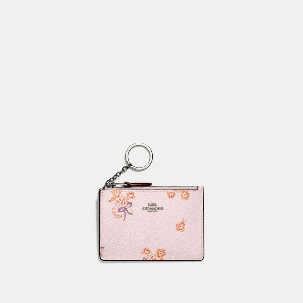 CARTERA PARA DOCUMENTOS MINI SKINNY CON ESTAMPADO FLORAL BOW
