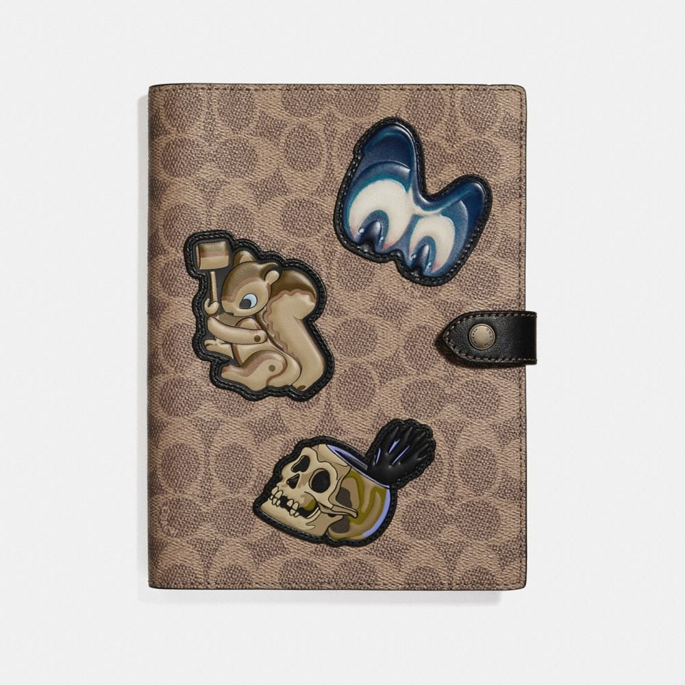 DISNEY X COACH SKETCHBOOK IN SIGNATURE PATCHWORK