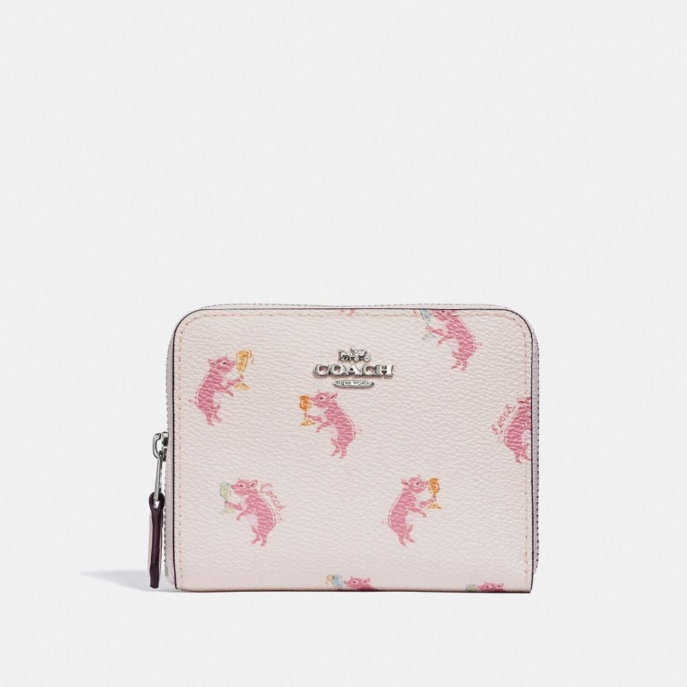 SMALL ZIP AROUND WALLET WITH PARTY PIG PRINT