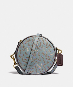 BUY NOW CIRCLE CROSSBODY WITH SQUIGGLE PRINT