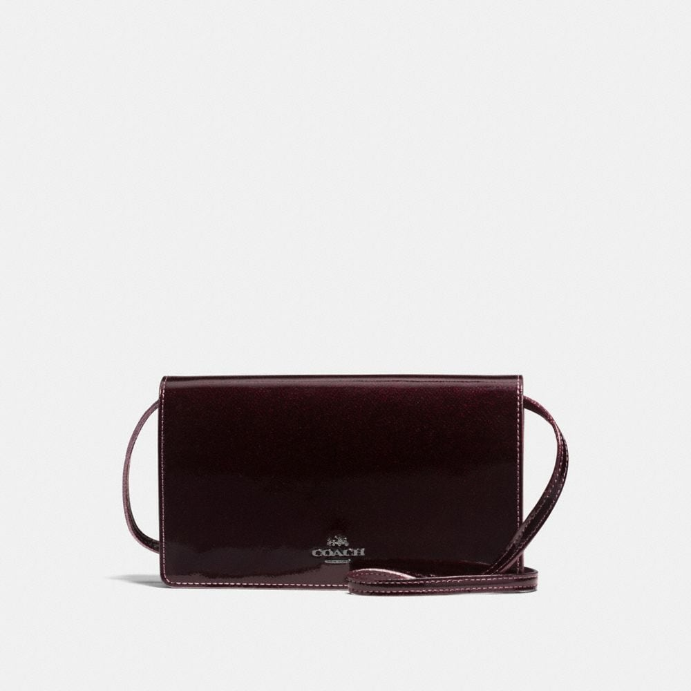 FOLDOVER CROSSBODY IN PATENT LEATHER
