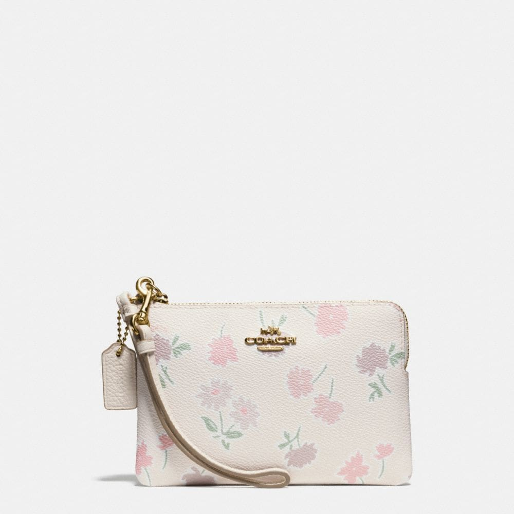 SMALL WRISTLET IN DAISY FIELD PRINT COATED CANVAS