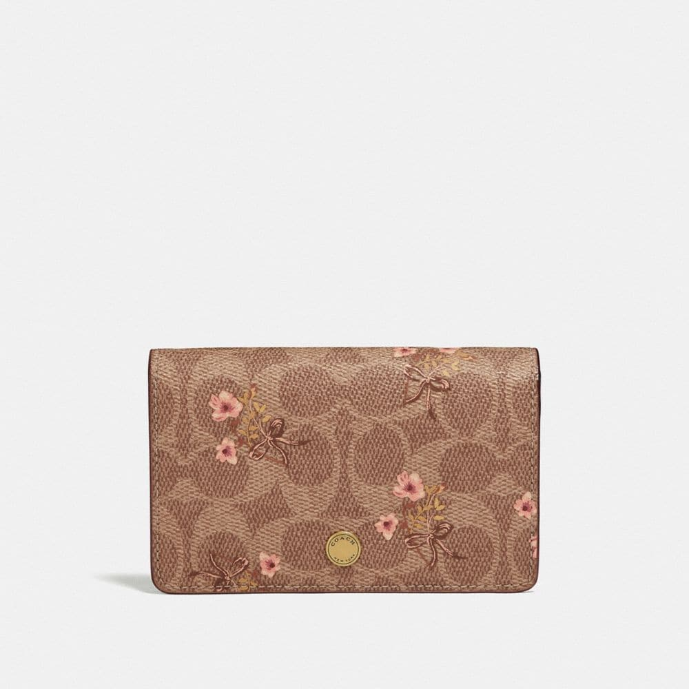 FOLDOVER CARD CASE IN SIGNATURE CANVAS WITH FLORAL BOW PRINT