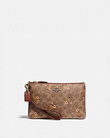 c235c42f03 SMALL WRISTLET IN SIGNATURE CANVAS WITH FLORAL BOW PRINT