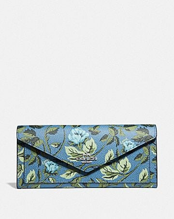 CARTERA SUAVE CON ESTAMPADO SLEEPING ROSE