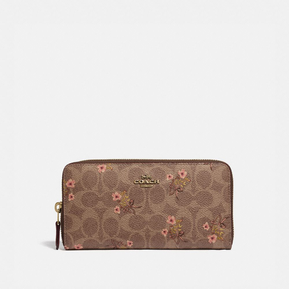 ACCORDION ZIP WALLET IN SIGNATURE CANVAS WITH FLORAL BOW PRINT