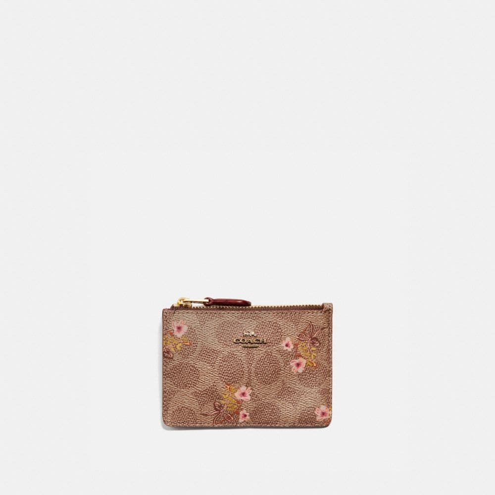 MINI SKINNY ID CASE IN SIGNATURE CANVAS WITH FLORAL BOW PRINT
