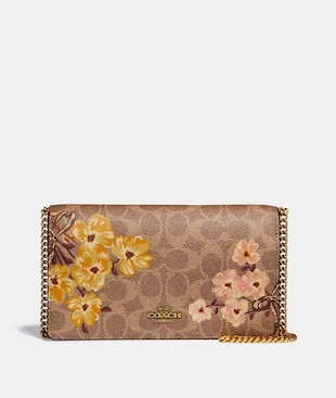 CALLIE FOLDOVER CHAIN CLUTCH IN SIGNATURE CANVAS WITH PRAIRIE FLORAL PRINT
