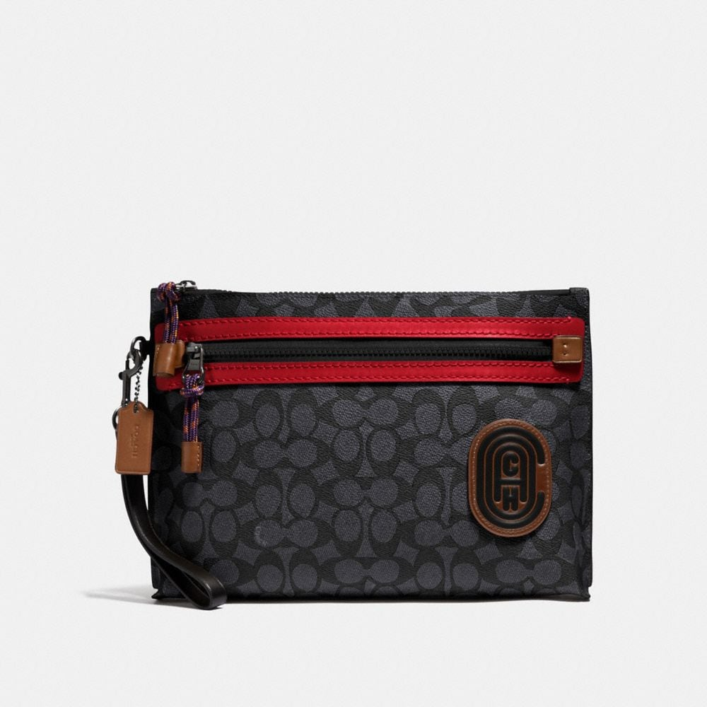 ACADEMY POUCH IN SIGNATURE CANVAS WITH COACH PATCH