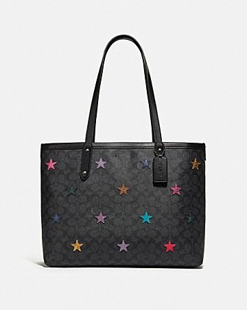CENTRAL TOTE IN SIGNATURE CANVAS WITH STAR APPLIQUE AND SNAKESKIN DETAIL