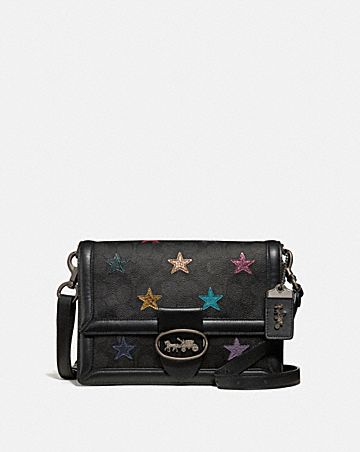 RILEY SHOULDER BAG IN SIGNATURE CANVAS WITH STAR APPLIQUE AND SNAKESKIN DETAIL