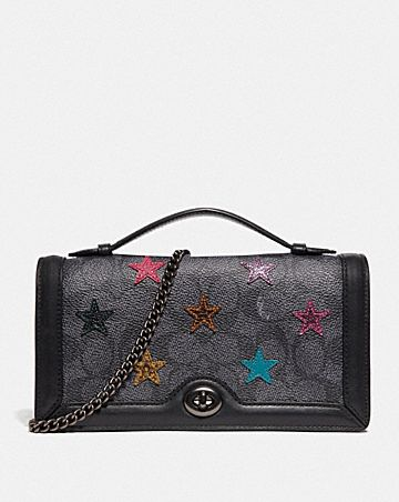 RILEY CHAIN CLUTCH IN SIGNATURE CANVAS WITH STAR APPLIQUE AND SNAKESKIN DETAIL