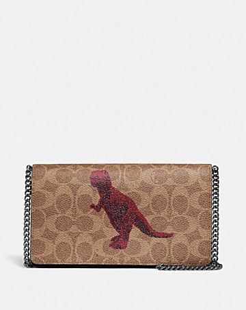 CALLIE FOLDOVER CHAIN CLUTCH IN SIGNATURE CANVAS WITH REXY BY SUI JIANGUO