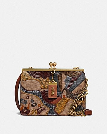 DOUBLE FRAME BAG IN SIGNATURE CANVAS WITH STARSCAPE PATCHWORK AND SNAKESKIN DETAIL