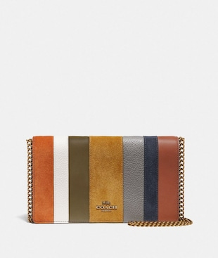 CALLIE FOLDOVER CHAIN CLUTCH WITH PATCHWORK STRIPES