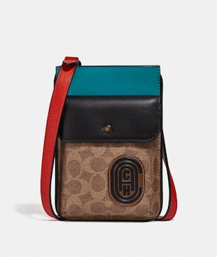 POCHETTE IBRIDA CON BLOCCHI IN TELA SIGNATURE E TOPPA COACH