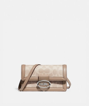 RILEY CONVERTIBLE BELT BAG IN COLORBLOCK SIGNATURE CANVAS