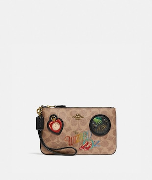 WIZARD OF OZ BOXED SMALL WRISTLET IN SIGNATURE CANVAS WITH PATCHES