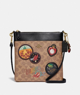 WIZARD OF OZ KITT MESSENGER CROSSBODY IN SIGNATURE CANVAS WITH PATCHES