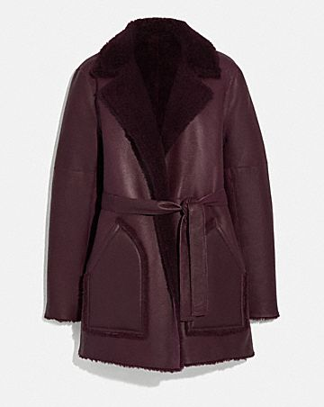 REVERSIBLE SHEARLING COAT WITH BELT