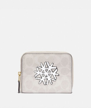SMALL ZIP AROUND WALLET IN SIGNATURE CANVAS WITH SNOWFLAKE