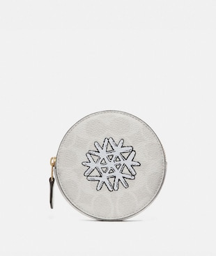 ROUND COIN CASE IN SIGNATURE CANVAS WITH SNOWFLAKE MOTIF