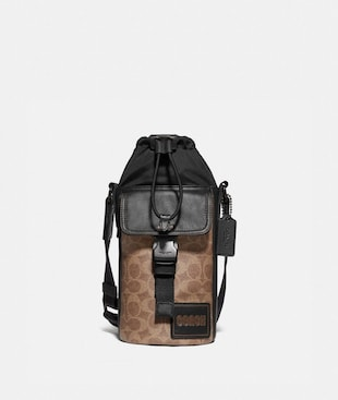 PACER DRAWSTRING CROSSBODY IN SIGNATURE CANVAS WITH COACH PATCH