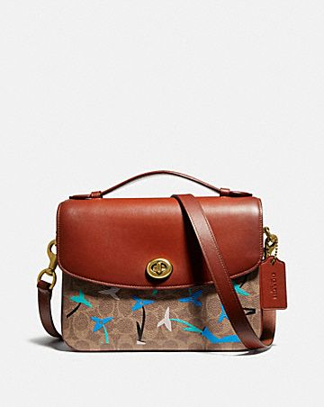 CASSIE CROSSBODY IN SIGNATURE CANVAS BLOCKING BY WE ARE OUT OF OFFICE