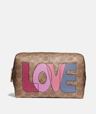 LARGE BOXY COSMETIC CASE IN SIGNATURE CANVAS WITH LOVE PRINT