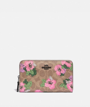 MEDIUM ZIP AROUND WALLET IN SIGNATURE CANVAS WITH BLOSSOM PRINT