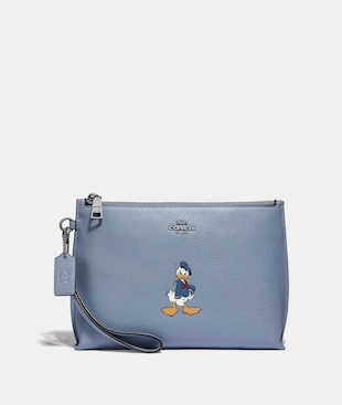 DISNEY X COACH CHARLIE POUCH WITH DONALD DUCK MOTIF