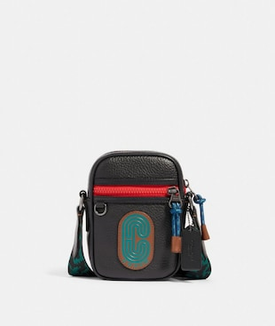 TERRAIN CROSSBODY IN COLORBLOCK WITH WAVY ANIMAL PRINT DETAIL AND COACH PATCH