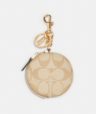 CIRCULAR COIN POUCH BAG CHARM IN SIGNATURE CANVAS