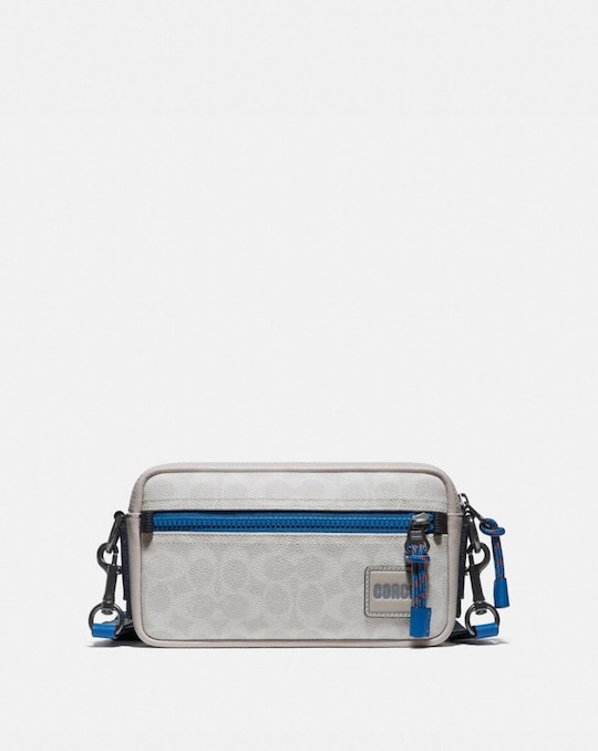 PACER SLIM POUCH IN SIGNATURE CANVAS