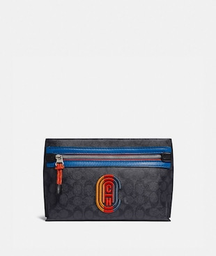 CONVERTIBLE ACADEMY POUCH IN SIGNATURE CANVAS WITH COACH PATCH