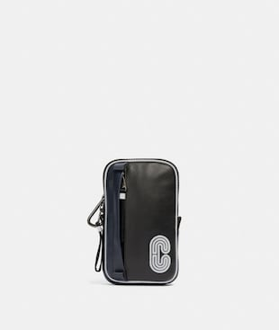 NORTH/SOUTH HYBRID POUCH WITH REFLECTIVE COACH PATCH