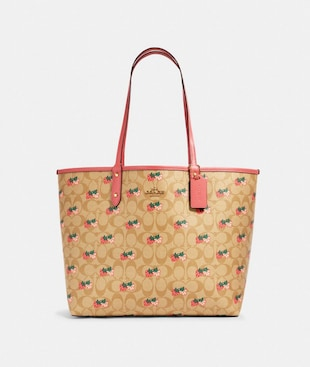 REVERSIBLE CITY TOTE IN SIGNATURE CANVAS WITH STRAWBERRY PRINT