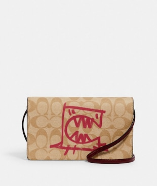ANNA FOLDOVER CROSSBODY CLUTCH IN SIGNATURE CANVAS WITH REXY BY GUANG YU