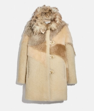 PIECED SHEARLING COAT